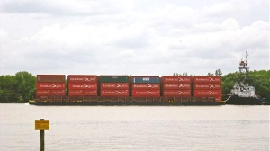 A push tug and barge transporting containers on the Rio Paraguay.
